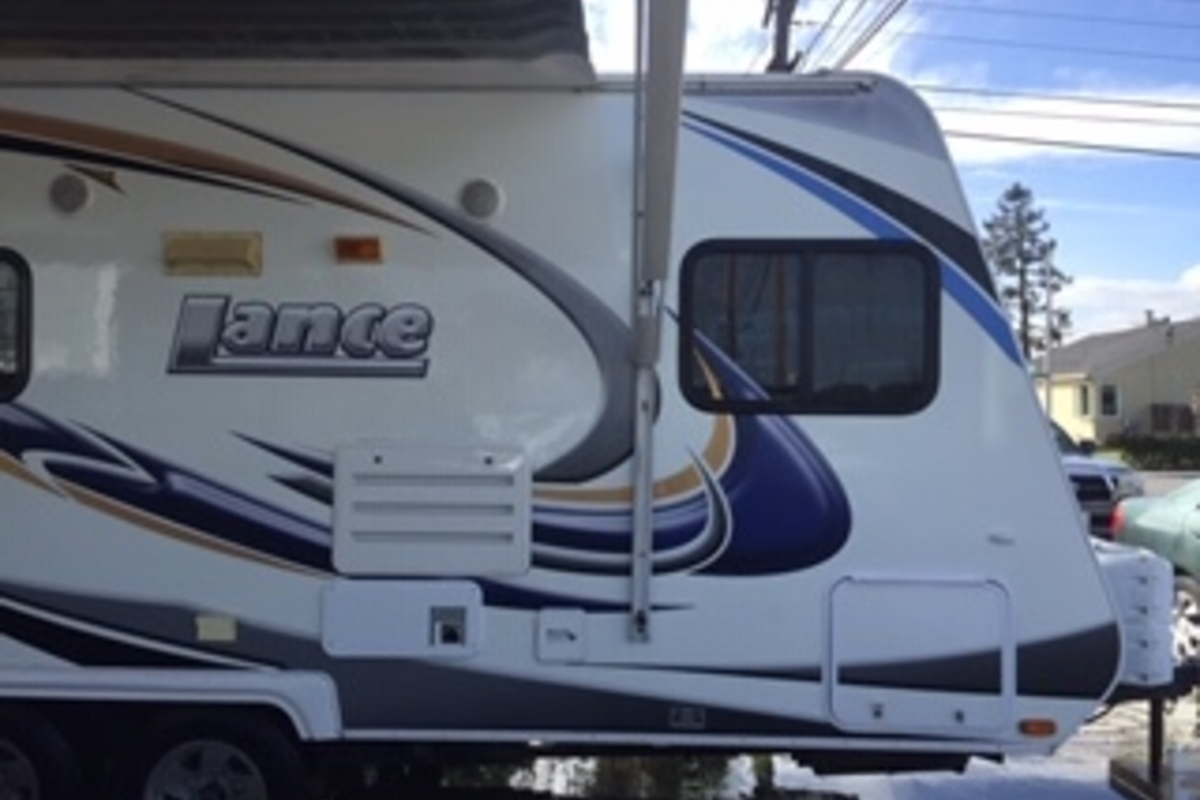 2011 Lance 1685 white with blue trim, 2